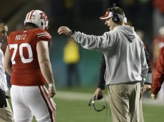 MADISON, WI - NOVEMBER 29: Head Coach Gary Anderson of the Wisconsin Badgers talks to Dan Voltz #70 as he walks off the field during the second half against the Minnesota Golden Gophers during the second half against the Wisconsin Badgers at Camp Randall Stadium on November 29, 2014 in Madison, Wisconsin. (Photo by Mike McGinnis/Getty Images)