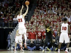 MADISON, WI - JANUARY 20: Josh Gasser #21 of the Wisconsin Badgers shoots a three pointer during the first half against the Iowa Hawkeyes at Kohl Center on January 20, 2015 in Madison, Wisconsin. (Photo by Mike McGinnis/Getty Images)  *** Local Caption *** Joesh Gasser