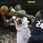 MADISON, WI - FEBRUARY 15: Nigel Hayes #10 of the Wisconsin Badgers draws the foul while driving to the hoop during the second half against the Illinois Fighting Illini at Kohl Center on February 15, 2015 in Madison, Wisconsin. (Photo by Mike McGinnis/Getty Images)  *** Local Caption *** Nigel Hayes