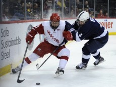 ST PAUL, MN - MARCH 21: Morgan Zulinick #15 of the Wisconsin Badgers controls the puck against Penn State Nittany Lions during the second period of the semifinal game of the Big Ten Men's Ice Hockey Championship on March 21, 2014 at Xcel Energy Center in St Paul, Minnesota. (Photo by Hannah Foslien/Getty Images)