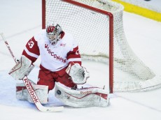 ST PAUL, MN - MARCH 22: Joel Rumpel #33 of the Wisconsin Badgers defends the net from a shot by the Ohio State Buckeyes during the Big Ten Men's Ice Hockey Championship game on March 22, 2014 at Xcel Energy Center in St Paul, Minnesota. (Photo by Hannah Foslien/Getty Images)