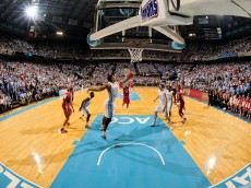 CHAPEL HILL, NC - NOVEMBER 30:  James Michael McAdoo #43 of the North Carolina Tar Heels rebounds a miss by Jordan Taylor #11 of the Wisconsin Badgers during play at the Dean Smith Center on November 30, 2011 in Chapel Hill, North Carolina. North Carolina won 60-57.  (Photo by Grant Halverson/Getty Images)