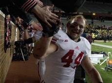 MINNEAPOLIS, MN - NOVEMBER 23: Chris Borland #44 of the Wisconsin Badgers celebrates a win of the game against the Minnesota Golden Gophers on November 23, 2013 at TCF Bank Stadium in Minneapolis, Minnesota. The Wisconsin Badgers defeated the Minnesota Golden Gophers 20-7. (Photo by Hannah Foslien/Getty Images)