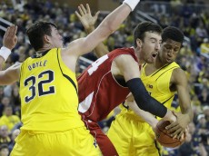 ANN ARBOR, MI - JANUARY 24:  Frank Kaminsky #44 of the Wisconsin Badgers has the ball knocked loose by Aubrey Dawkins #24 of the Michigan Wolverines as Ricky Doyle #32 helps defend during overtime of a Big Ten game at Crisler Arena on January 24, 2015 in Ann Arbor, Michigan. Wisconsin defeated Michigan 69-64. (Photo by Duane Burleson/Getty Images)