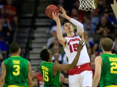 OMAHA, NE - MARCH 22: Sam Dekker #15 of the Wisconsin Badgers pulls in a rebound in front of Jalil Abdul-Bassit #15 of the Oregon Ducks in the first half during the third round of the 2015 NCAA Men's Basketball Tournament at the CenturyLink Center on March 22, 2015 in Omaha, Nebraska.  (Photo by Jamie Squire/Getty Images)