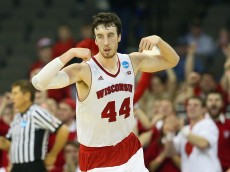 OMAHA, NE - MARCH 22: Frank Kaminsky #44 of the Wisconsin Badgers reacts during the third round of the 2015 NCAA Men's Basketball Tournament at the CenturyLink Center on March 22, 2015 in Omaha, Nebraska  (Photo by Ronald Martinez/Getty Images)