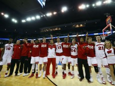 OMAHA, NE - MARCH 22:  The Wisconsin Badgers celebrate their win against the Oregon Ducks during the third round of the 2015 NCAA Men's Basketball Tournament  at CenturyLink Center on March 22, 2015 in Omaha, Nebraska.  (Photo by Ronald Martinez/Getty Images)