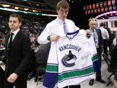 ST PAUL, MN - JUNE 25:  101st overall pick Joseph Labate by the Vancouver Canucks holds up a Canucks jersey during day two of the 2011 NHL Entry Draft at Xcel Energy Center on June 25, 2011 in St Paul, Minnesota.  (Photo by Bruce Bennett/Getty Images)