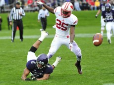 EVANSTON, IL- OCTOBER 04: Tony Jones #6 of the Northwestern Wildcats is defended by Derrick Tindal #25 of the Wisconsin Badgers during the first half on October 4, 2014 at Ryan Field in Evanston, Illinois.  (Photo by David Banks/Getty Images)