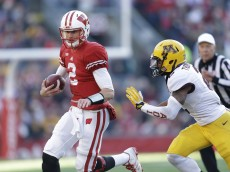 MADISON, WI - NOVEMBER 29: Joel Stave #2 of the Wisconsin Badgers runs with the football during the first half of play against the Minnesota Golden Gophers at Camp Randall Stadium on November 29, 2014 in Madison, Wisconsin. (Photo by Mike McGinnis/Getty Images)