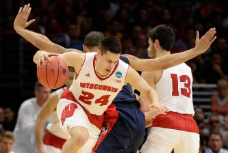 LOS ANGELES, CA - MARCH 28:  Bronson Koenig #24 uses a screen by Duje Dukan #13 of the Wisconsin Badgers to try to get around Brandon Ashley #21 of the Arizona Wildcats in the first half during the West Regional Final of the 2015 NCAA Men's Basketball Tournament at Staples Center on March 28, 2015 in Los Angeles, California.  (Photo by Harry How/Getty Images)