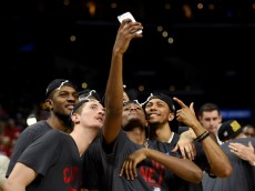 LOS ANGELES, CA - MARCH 28:  The Wisconsin Badgers take a selfie after the badgers 85-78 victory against the Arizona Wildcats during the West Regional Final of the 2015 NCAA Men's Basketball Tournament at Staples Center on March 28, 2015 in Los Angeles, California.  (Photo by Harry How/Getty Images)