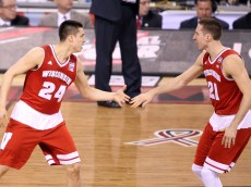 INDIANAPOLIS, IN - APRIL 04: Bronson Koenig #24 and Josh Gasser #21 of the Wisconsin Badgers celebrate after a play in the second half against the Kentucky Wildcats during the NCAA Men's Final Four Semifinal at Lucas Oil Stadium on April 4, 2015 in Indianapolis, Indiana.  (Photo by Joe Robbins/Getty Images)
