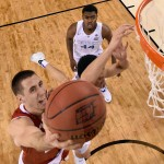 INDIANAPOLIS, IN - APRIL 04: Josh Gasser #21 of the Wisconsin Badgers drives to the basket against Devin Booker #1 and Dakari Johnson #44 of the Kentucky Wildcats in the second half during the NCAA Men's Final Four Semifinal at Lucas Oil Stadium on April 4, 2015 in Indianapolis, Indiana.  (Photo by Chris Steppig - Pool/Getty Images)