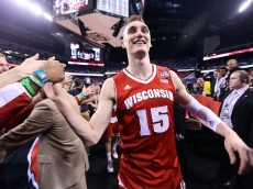 INDIANAPOLIS, IN - APRIL 04: Sam Dekker #15 of the Wisconsin Badgers celebrates after defeating the Kentucky Wildcats during the NCAA Men's Final Four Semifinal at Lucas Oil Stadium on April 4, 2015 in Indianapolis, Indiana. Wisconsin defeated Kentucky  71-64.  (Photo by Streeter Lecka/Getty Images)