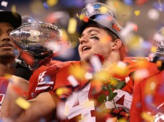 INDIANAPOLIS, IN - DECEMBER 01:  Chris Borland #44 of the Wisconsin Badgers celebrates the Big Ten Championship holding the Amos Alonzo Stagg Championship Trophy after defeating the Nebraska Cornhuskers 70-31 at Lucas Oil Stadium on December 1, 2012 in Indianapolis, Indiana.  (Photo by Leon Halip/Getty Images)