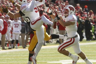 IOWA CITY, IA - NOVEMBER 2:  Cornerback Darius Hillary #5 of the Wisconsin Badgers intercepts a pass during the third quarter intended for tight end C.J. Fiedorowicz #86 of the Iowa Hawkeyes on November 2, 2013 at Kinnick Stadium in Iowa City, Iowa. Wisconsin won 28-9. (Photo by Matthew Holst/Getty Images)