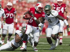 MADISON, WI - SEPTEMBER 27:  Running back Corey Clement #6 of the Wisconsin Badgers breaks a tackle against linebacker Reshard Cliett #16 of the South Florida Bulls during the third quarter on September 27, 2014 at Camp Randall Stadium in Madison, Wisconsin.  The Wisconsin Badgers defeated the South Florida Bulls 27-10.  (Photo by Tom Lynn/Getty Images)