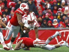 MADISON, WI - NOVEMBER 15:  Tommy Armstrong Jr. #4 of the Nebraska Cornhuskers is tackled by Chikwe Obasih #34 of the Wisconsin Badgers, left and Michael Caputo #7, right at Camp Randall Stadium on November 15, 2014 in Madison, Wisconsin.  (Photo by Ronald Martinez/Getty Images)