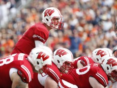 TAMPA, FL - JANUARY 1:  Quarterback Joel Stave #2 of the Wisconsin Badgers controls the offense during the first quarter of the Outback Bowl against the Auburn Tigers on January 1, 2015 at Raymond James Stadium in Tampa, Florida.  (Photo by Brian Blanco/Getty Images)