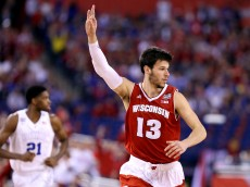 INDIANAPOLIS, IN - APRIL 06: Duje Dukan #13 of the Wisconsin Badgers reacts after a play in the first half against the Duke Blue Devils during the NCAA Men's Final Four National Championship at Lucas Oil Stadium on April 6, 2015 in Indianapolis, Indiana.  (Photo by Streeter Lecka/Getty Images)
