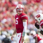 MADISON, WI - SEPTEMBER 27:  Tanner McEvoy #5 of the Wisconsin Badgers looks over the South Florida Bulls defense on September 27, 2014 at Camp Randall Stadium in Madison, Wisconsin.  (Photo by Tom Lynn/Getty Images)