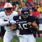 EVANSTON, IL- OCTOBER 04:  Dan Vitale #40 of the Northwestern Wildcats catches a touchdown pass against Leon Jacobs #32 of the Wisconsin Badgers during the first half on October 4, 2014 at Ryan Field in Evanston, Illinois.  (Photo by David Banks/Getty Images)