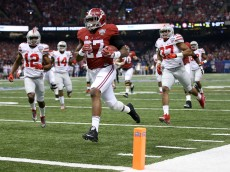 NEW ORLEANS, LA - JANUARY 01:  Derrick Henry #27 of the Alabama Crimson Tide scores a 25 yard touchdown in the first quarter against the Ohio State Buckeyes during the All State Sugar Bowl at the Mercedes-Benz Superdome on January 1, 2015 in New Orleans, Louisiana.  (Photo by Chris Graythen/Getty Images)