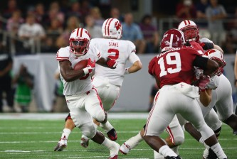 ARLINGTON, TX - SEPTEMBER 05:  Corey Clement #6 of the Wisconsin Badgers runs the ball against the Alabama Crimson Tide during the Advocare Classic at AT&T Stadium on September 5, 2015 in Arlington, Texas.  (Photo by Ronald Martinez/Getty Images)