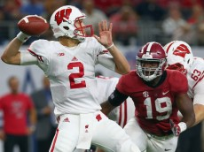 ARLINGTON, TX - SEPTEMBER 05:  Joel Stave #2 of the Wisconsin Badgers looks for an ope receiver under pressure from Reggie Ragland #19 of the Alabama Crimson Tide in the second half during The Advocare Classic at AT&T Stadium on September 5, 2015 in Arlington, Texas.  (Photo by Tom Pennington/Getty Images)