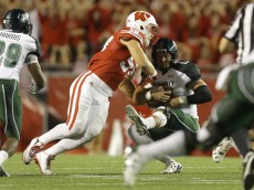 MADISON, WI - SEPTEMBER 26: Joe Schubert #58 of the Wisconsin Badgers tackles Max Wittek #13 of the Hawaii Rainbow Warriors during the first half at Camp Randall Stadium on September 26, 2015 in Madison, Wisconsin. (Photo by Mike McGinnis/Getty Images)