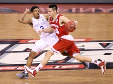 INDIANAPOLIS, IN - APRIL 04: Bronson Koenig #24 of the Wisconsin Badgers handles the ball against Tyler Ulis #3 of the Kentucky Wildcats in the first half during the NCAA Men's Final Four Semifinal at Lucas Oil Stadium on April 4, 2015 in Indianapolis, Indiana.  (Photo by Joe Robbins/Getty Images)