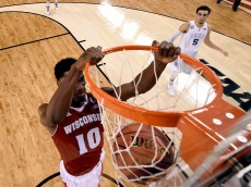 INDIANAPOLIS, IN - APRIL 06: Nigel Hayes #10 of the Wisconsin Badgers goes up for a dunk in the second half against Tyus Jones #5 of the Duke Blue Devils during the NCAA Men's Final Four National Championship at Lucas Oil Stadium on April 6, 2015 in Indianapolis, Indiana.  (Photo by Chris Steppig - Pool/Getty Images)