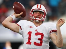 ARLINGTON, TX - SEPTEMBER 05:  Bart Houston #13 of the Wisconsin Badgers throws before the Advocare Classic against the Alabama Crimson Tide at AT&T Stadium on September 5, 2015 in Arlington, Texas.  (Photo by Ronald Martinez/Getty Images)