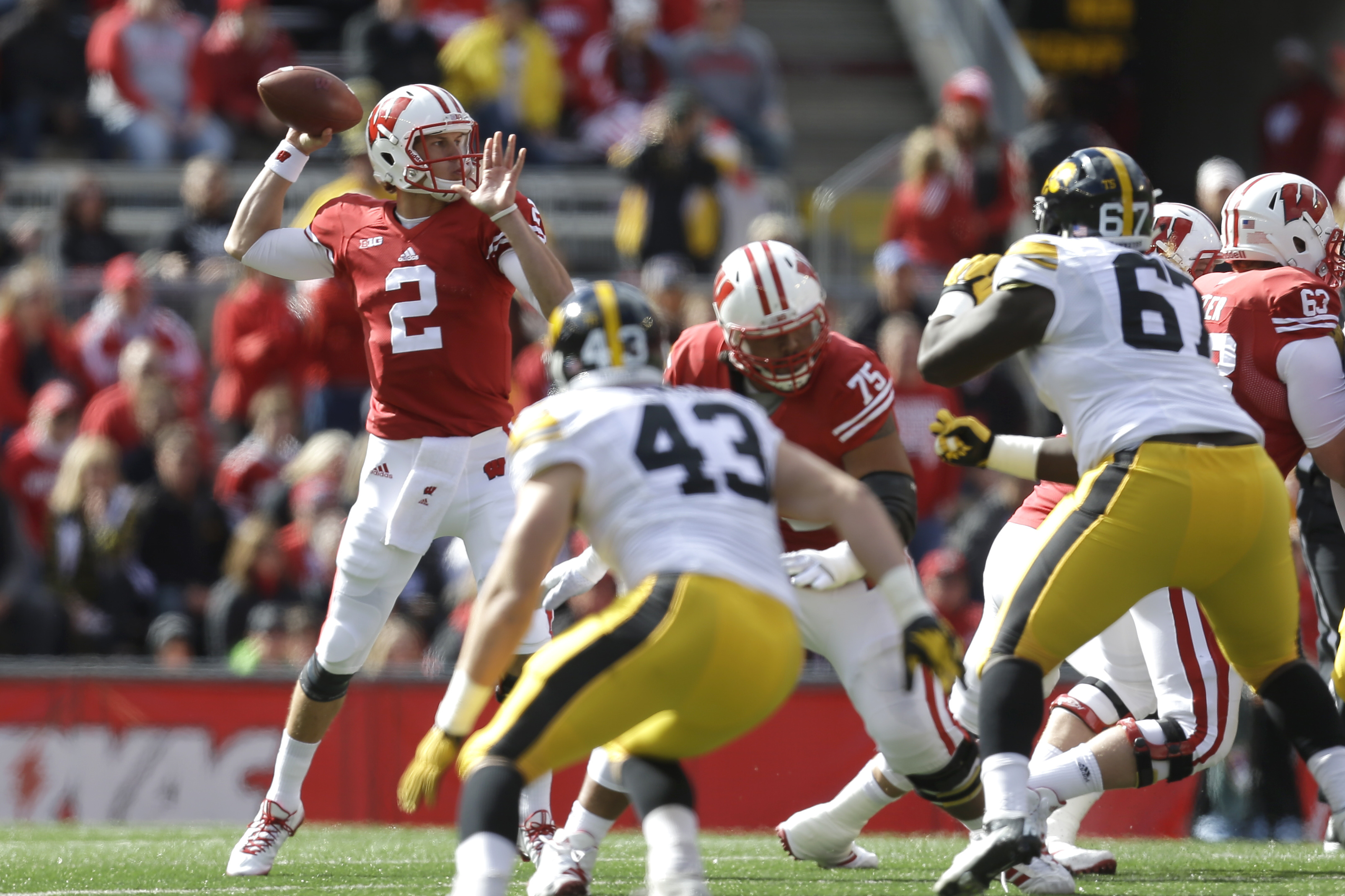 MADISON, WI - OCTOBER 03: Joel Stave #2 of the Wisconsin Badgers drops back and passes the football during the first half against the Iowa Hawkeyes at Camp Randall Stadium on October 03, 2015 in Madison, Wisconsin. (Photo by Mike McGinnis/Getty Images)