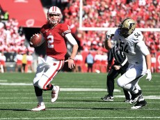 MADISON, WI - OCTOBER 17:  Joel Stave #2 of the Wisconsin Badgers is pursued by Jake Replogle #54 of the Purdue Boilermakers during the first quarter of a game against the Purdue Boilermakers at Camp Randall Stadium on October 17, 2015 in Madison, Wisconsin.  (Photo by Stacy Revere/Getty Images)