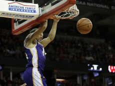 MADISON, WI - JANUARY 15: J.C. Fuller #14 of the Western Illinois Leathernecks with the two handed jam during the second half against Wisconsin Badgers at Kohl Center on November 13, 2015 in Madison, Wisconsin. (Photo by Mike McGinnis/Getty Images)  *** Local Caption *** J.C. Fuller