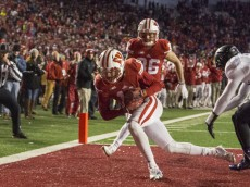MADISON, WI - NOVEMBER 21: Wide receiver Jazz Peavy #11 of the Wisconsin Badgers makes what looks like a touchdown catch against Nick VanHoose #23 of the Northwestern Wildcats on November 21, 2015 at Camp Randall Stadium in Madison, Wisconsin. The review reversed the call forcing a 4th down. (Photo by Tom Lynn/Getty Images)