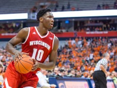 SYRACUSE, NY - DECEMBER 02:  Nigel Hayes #10 of the Wisconsin Badgers handles the ball during the first half against the Syracuse Orange on December 2, 2015 at The Carrier Dome in Syracuse, New York.  (Photo by Brett Carlsen/Getty Images)