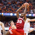 SYRACUSE, NY - DECEMBER 02:  Vitto Brown #30 of the Wisconsin Badgers pulls in a rebound during the first half against the Syracuse Orange on December 2, 2015 at The Carrier Dome in Syracuse, New York.  (Photo by Brett Carlsen/Getty Images)
