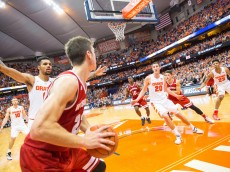 SYRACUSE, NY - DECEMBER 02:  Ethan Happ #22 of the Wisconsin Badgers inbounds the ball during overtime against the Syracuse Orange on December 2, 2015 at The Carrier Dome in Syracuse, New York.  Wisconsin defeats Syracuse 66-58 in overtime.  (Photo by Brett Carlsen/Getty Images)