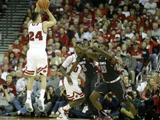 MADISON, WI - DECEMBER 05: Bronson Koenig #24 of the Wisconsin Badgers shoots a three pointer during the second half against the Temple Owls at Kohl Center on December 05, 2015 in Madison, Wisconsin. (Photo by Mike McGinnis/Getty Images)