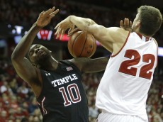 MADISON, WI - DECEMBER 05: Mark Williams #10 of the Temple Owls draws the foul from EtahnHapp #22 of the  Wisconsin Badgers during the second half at Kohl Center on December 05, 2015 in Madison, Wisconsin. (Photo by Mike McGinnis/Getty Images)  *** Local Caption *** Mark Williams; Ethan Happ