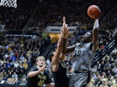 WEST LAFAYETTE, IN- DECEMBER 22: Caleb Swanigan #50 of the Purdue Boilermakers shoots the ball over Wade Baldwin IV #4 of the Vanderbilt Commodores during the game on December 22, 2015 at Mackey Arena in West Lafayette, Indiana. Purdue won the game 68-55. (Photo by John Weast/Getty Images)