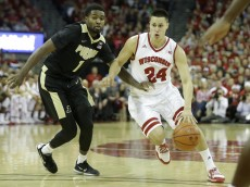 MADISON, WI - DECEMBER 29: Bronson Koenig #24 of the Wisconsin Badgers drives to the hoop for two points during the first half against the Purdue Boilermakers at Kohl Center on December 29, 2015 in Madison, Wisconsin. (Photo by Mike McGinnis/Getty Images)