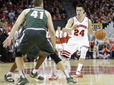 MADISON, WI - JANUARY 17: Bronson Keonig #24 of the Wisconsin Badgers dribbles up the court during the first half against the Michigan State Spartans at Kohl Center on January 17, 2016 in Madison, Wisconsin. (Photo by Mike McGinnis/Getty Images)