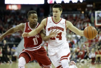 MADISON, WI - JANUARY 26: Bronson Koenig #24 of the Wisconsin Badgers drives against Kevin Yogi Ferrell #11 of the Indiana Hoosiers during the first half half against Wisconsin Badgers at Kohl Center on January 26, 2016 in Madison, Wisconsin. (Photo by Mike McGinnis/Getty Images)  *** Local Caption *** Bronson Koenig; Kevin Yogi Ferrell