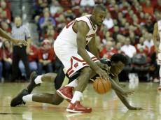 MADISON, WI - DECEMBER 29: Vitto Brown #30 of the Wisconsin Badgers and Caleb Swanigan #50 of the Purdue Boilermakers scramble for a loose ball at Kohl Center on December 29, 2015 in Madison, Wisconsin. (Photo by Mike McGinnis/Getty Images)