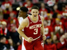 COLLEGE PARK, MD - FEBRUARY 13:  Zak Showalter #3 of the Wisconsin Badgers celebrates after hitting a three pointer against the Maryland Terrapins in the second half at Xfinity Center on February 13, 2016 in College Park, Maryland. Wisconsin won 70-57.  (Photo by Rob Carr/Getty Images)