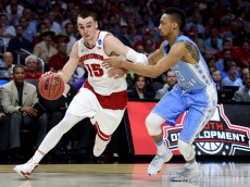 LOS ANGELES, CA - MARCH 26:  Sam Dekker #15 of the Wisconsin Badgers drives on J.P. Tokoto #13 of the North Carolina Tar Heels in the second half during the West Regional Semifinal of the 2015 NCAA Men's Basketball Tournament at Staples Center on March 26, 2015 in Los Angeles, California.  (Photo by Harry How/Getty Images)